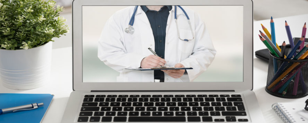 doctor on laptop for telehealth appointment